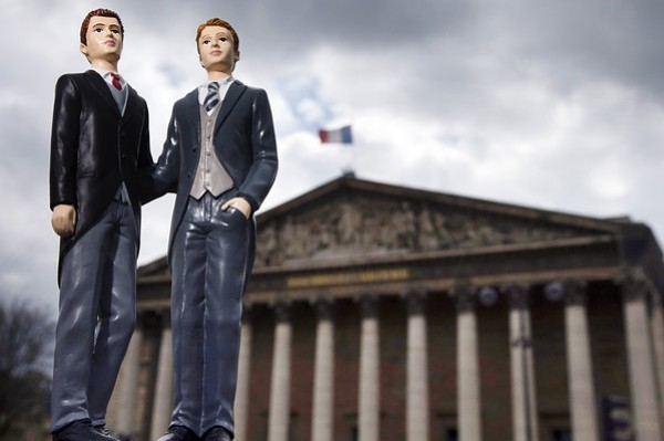 Picture taken on April 23, 2013 in Paris shows an illustration made with plastic figurines of men in front of the Palais Bourbon, the seat of the French National Assembly. After months of acrimonious debate and hundreds of protests that have occasionally spilled over into violence, France's National Assembly is due to approve today a bill making the country the 14th to legalise same-sex marriage. AFP PHOTO / JOEL SAGET (Photo credit should read JOEL SAGET/AFP/Getty Images)